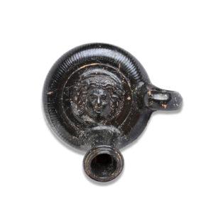 Greek guttus with Medusa head