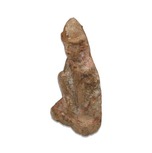 Roman statuette of a crouching figure with hat
