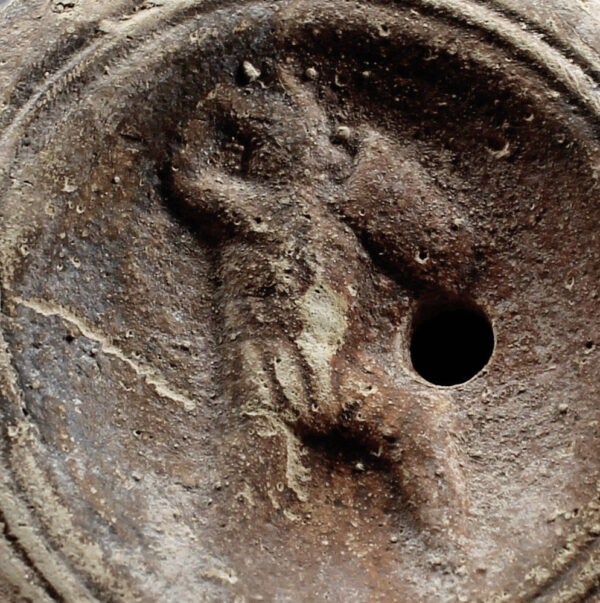 Roman oil lamp with a gladiator