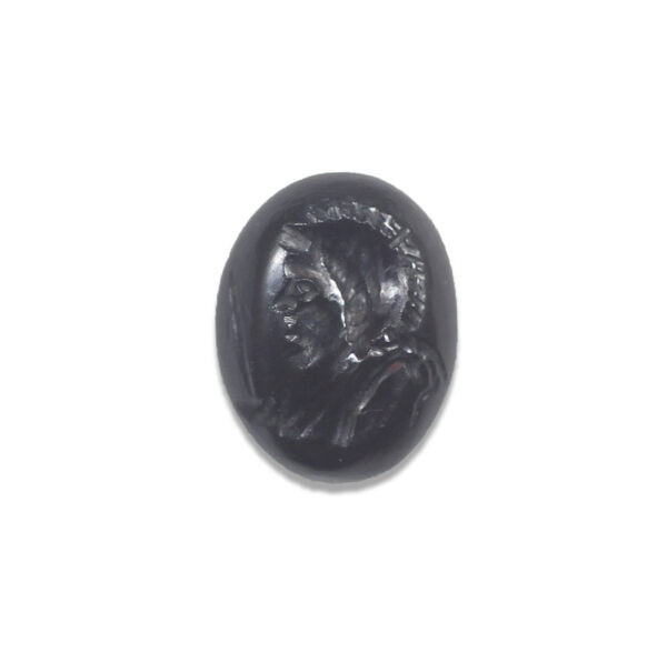 Roman intaglio stone depicting helmeted bust of Mars with shield