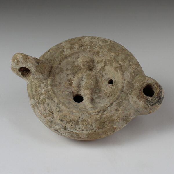Roman oil lamp with winged genie